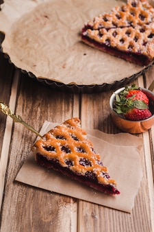 Delicious pie and small ladle with strawberries