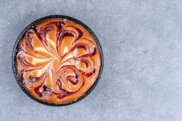 Delicious pie with berry on marble surface