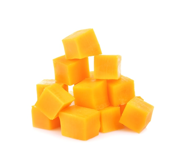 Delicious pieces of cheddar on white background