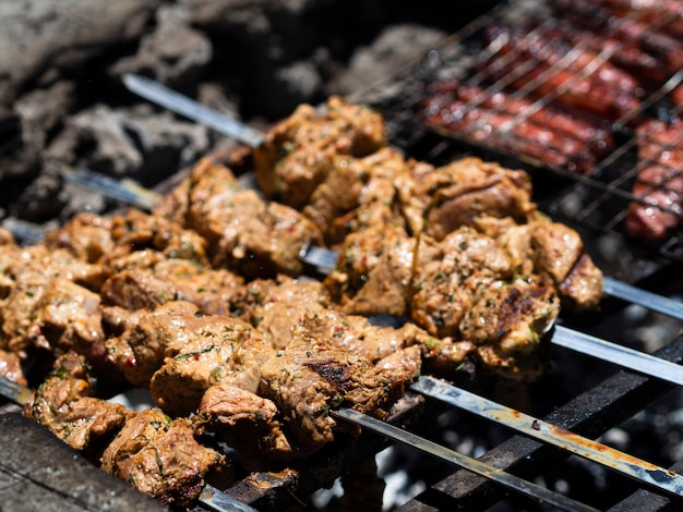 Delicious pieces of meat roasting on skewers