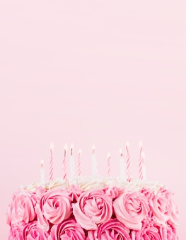 Delicious pink cake with candles