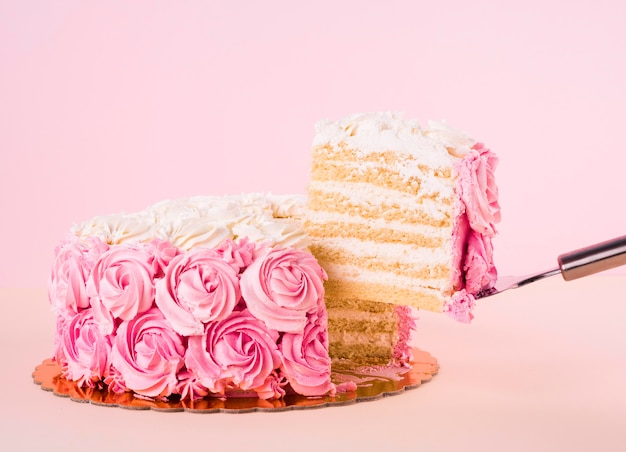 Delicious pink cake with roses shapes