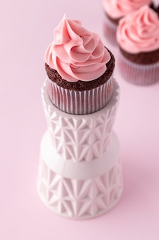 Delicious pink cupcake high angle