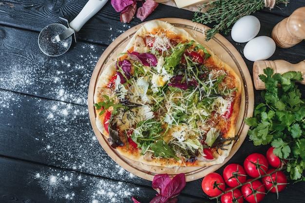 Delicious pizza on dark wooden background