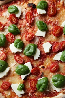 Delicious pizza with basil