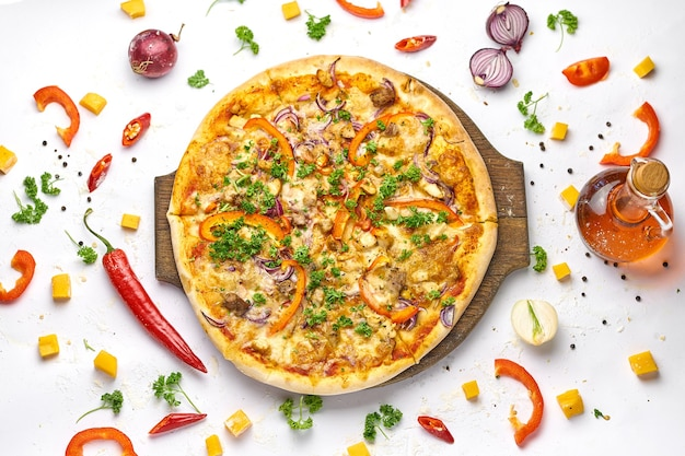 Delicious pizza with chicken, onion, mushrooms and sweet pepper on wooden plate. white background, tasty composition.