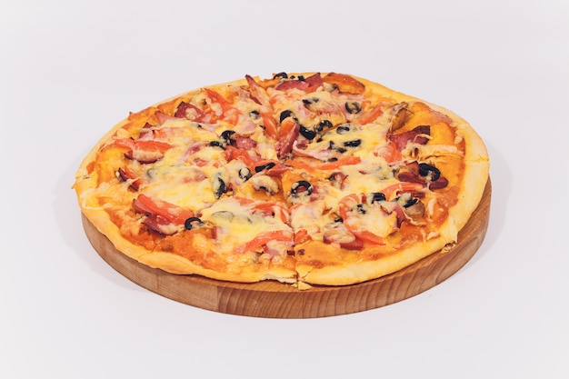 Delicious pizza with seafood on wooden stand isolated on white.