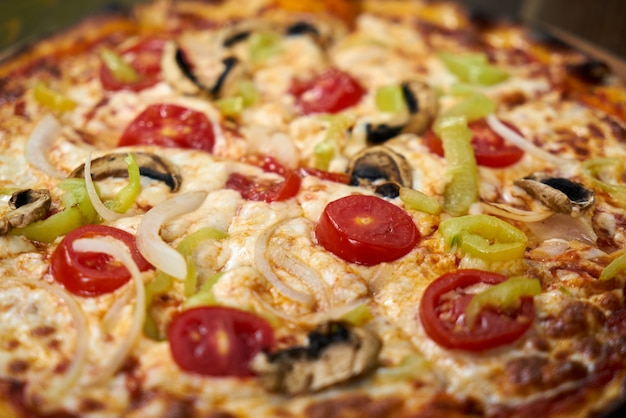 Delicious pizza with vegetables on the table