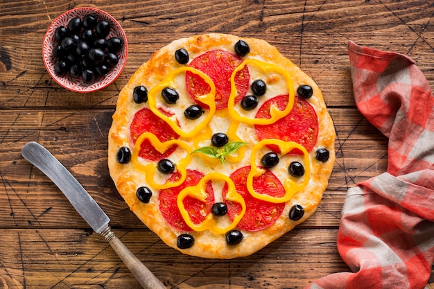 Delicious pizza on wooden table