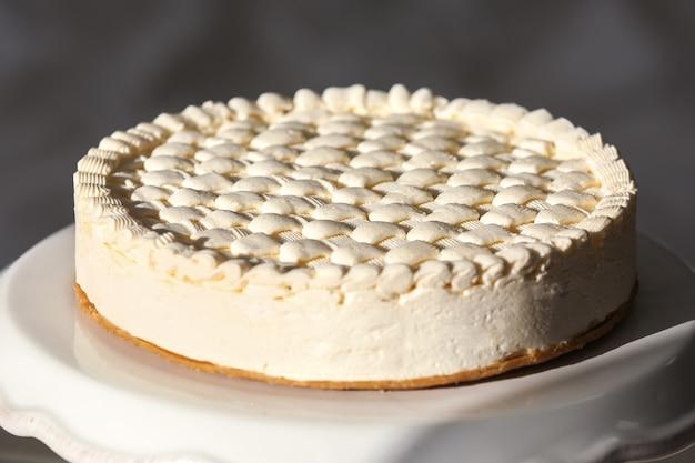 Delicious plain cheesecake on white stand