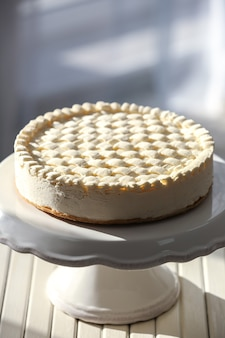 Delicious plain cheesecake on wooden table