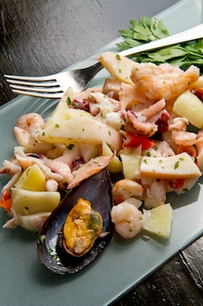 Delicious plate with seafood salad