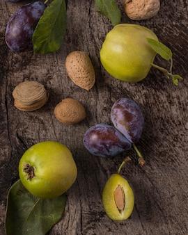 Delicious plums arrangement above view