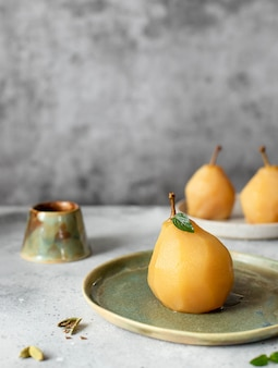 Delicious poached golden pear in spicy syrup