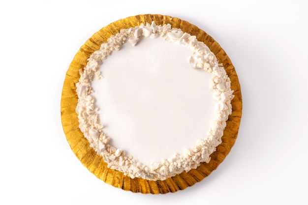 Delicious polvito uruguayo cake with sugar and caramel isolated on white surface