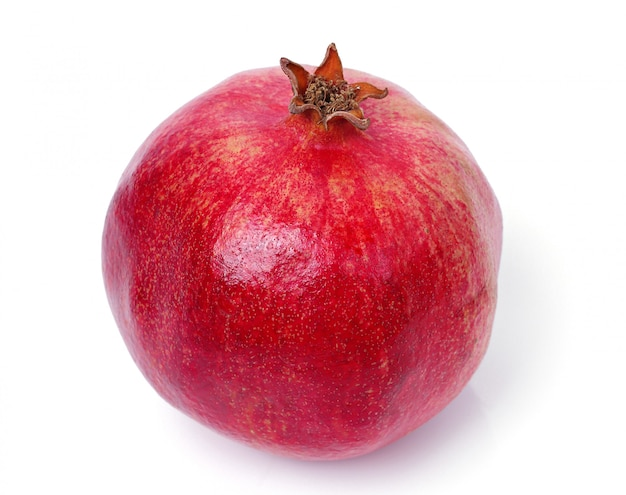 Delicious pomegranate on white