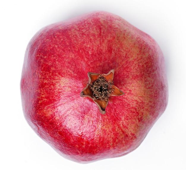 Delicious pomegranate on white