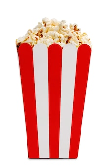 Delicious popcorn in decorative paper popcorn bucket isolated on white background.