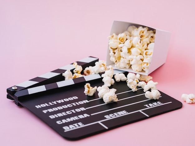 Delicious popcorn on top of clapperboard