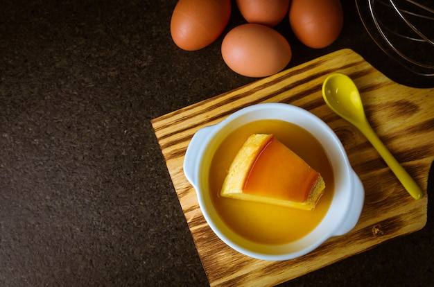 Delicious pudding, dessert made with eggs and milk, traditional brazilian dessert, served with caramel sauce on top.