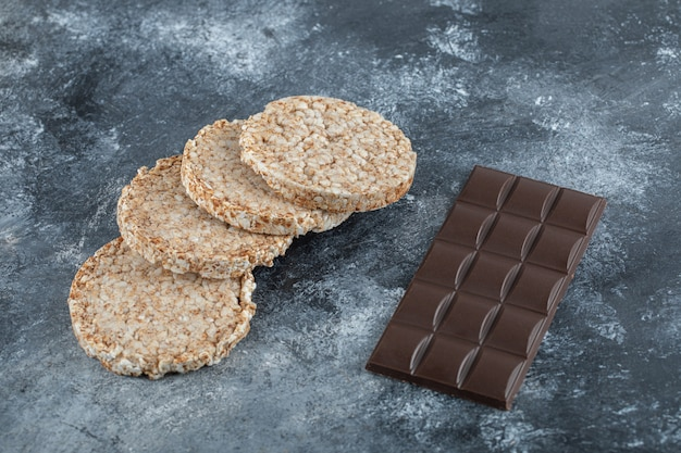 Delicious puffed rice bread with bar of chocolate .