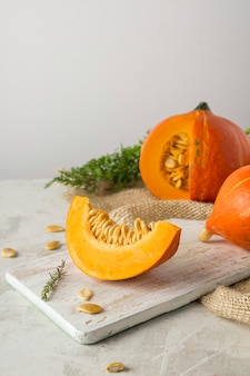 Delicious pumpkin on wooden board