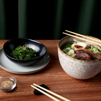 Delicious ramen with seaweed salad concept