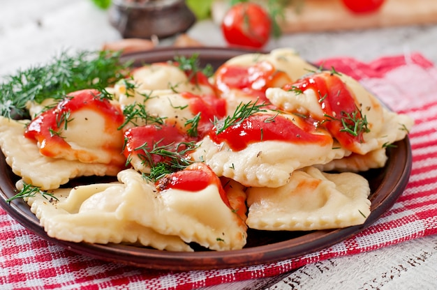 Delicious ravioli with tomato sauce and dill