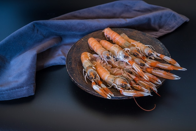 Delicious raw langoustines on dark
