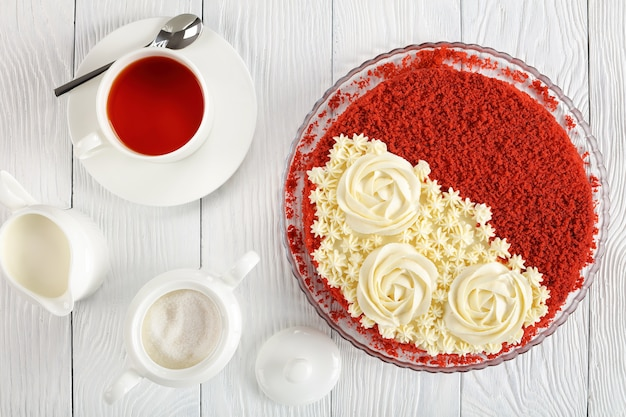 Delicious red velvet cake topped with beautiful creamy roses