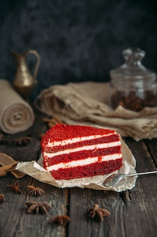 Delicious red velvet cake on a wooden table