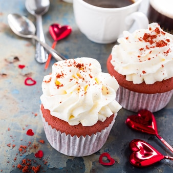 Delicious red velvet cupcakes on rusty old metal surface. valentines day food