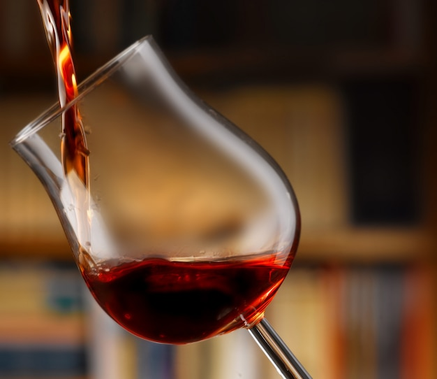Delicious red wine poured into a glass