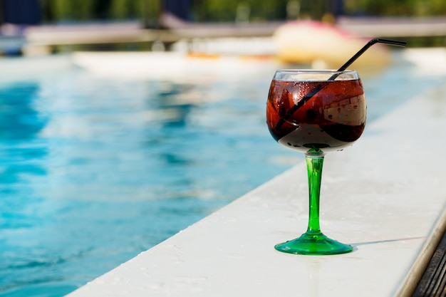 Delicious refreshing cocktail near the swimming pool