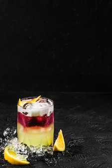 Delicious refreshing cocktail of orange and berries with ice
