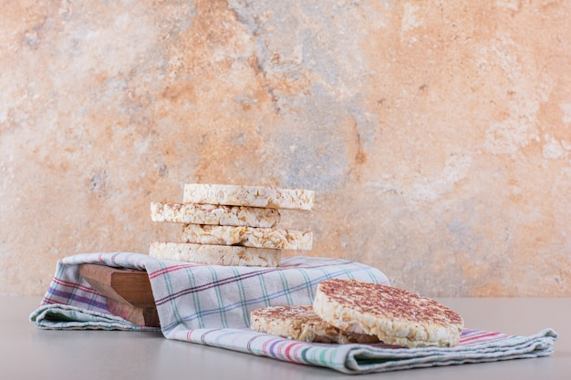 Delicious rice cakes with tablecloth placed on white table. high quality photo