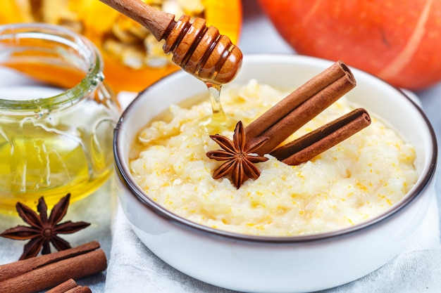 Delicious rice porridge with pumpkin, honey, cinnamon and star anise
