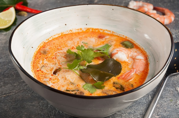 Delicious rich spicy asian tom yam soup with seafood