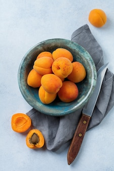 Delicious ripe apricots on a light concrete