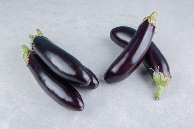 Delicious ripe eggplants, on the white surface