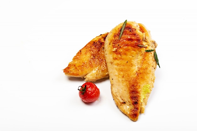 Delicious roasted chicken breast on white background