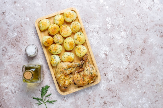 Delicious roasted young potatoes with dill and chicken,top view