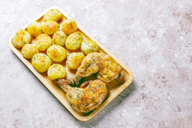 Delicious roasted young potatoes with dill and chicken