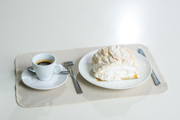 A delicious roll of bezrukov and a cup of coffee on a table in a cozy coffee shop