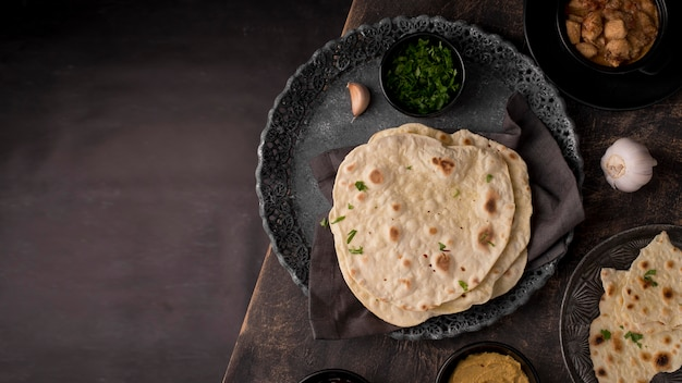 Delicious roti arrangement on the table with copy space