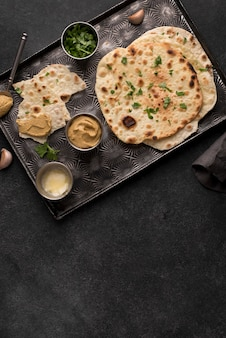 Delicious roti assortment on the table with copy space