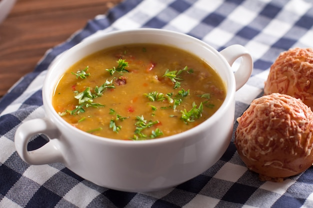 Delicious rustic soup with vegetables, lentils and peas