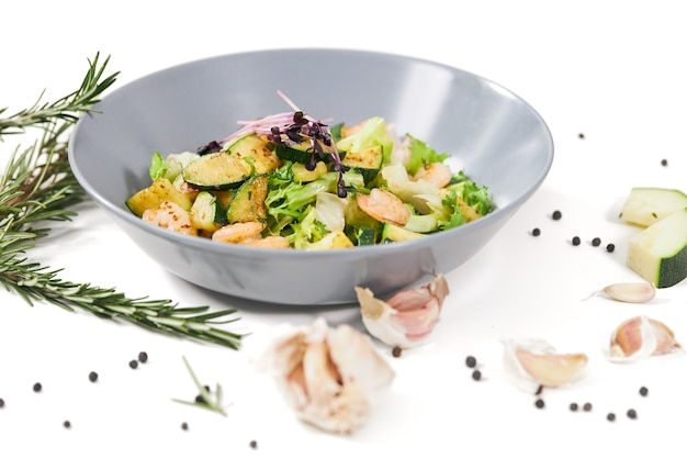 Delicious salad with herbs shrimps and zucchini