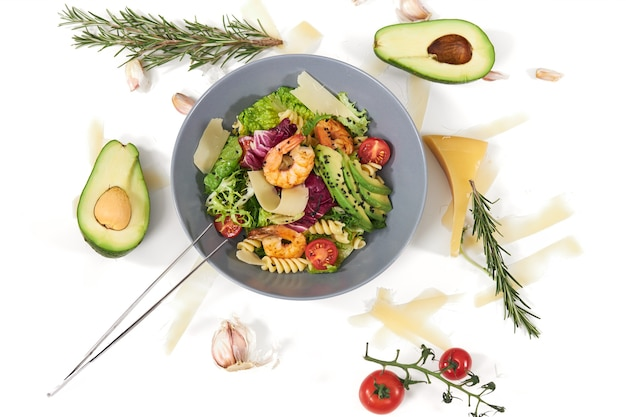 Delicious salad with pasta and seafood in beautiful plate