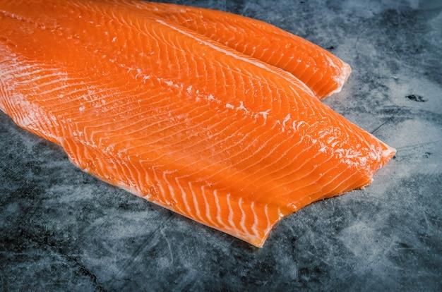 Delicious salmon fillet on dark